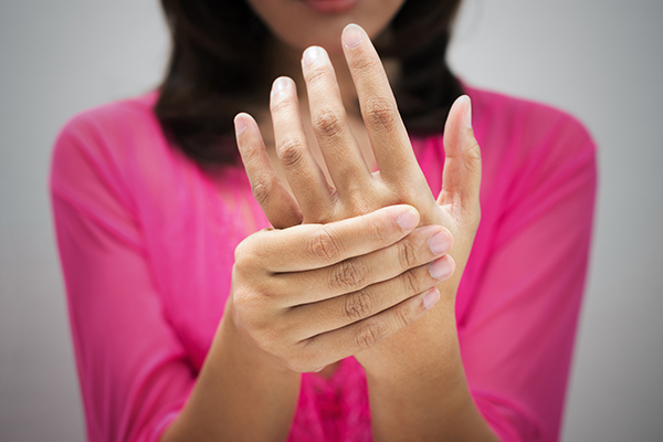 Image of woman with sore fingers