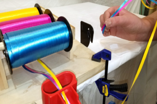 Image of EZ Tie™ Balloon Tying Station Ribbon Cutter Step 2